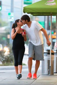 *EXCLUSIVE* Ashton and Mila feed her cravings with a Frozen Yogurt and a Kiss