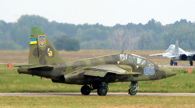 Ukrainian_Air_Force_Su-25UB_with_two_MiG-29s_9-13_in_background