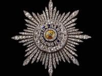 Знаци на  ордена Андрей  Първозваний - кръст с изображение на  разпънатия Свети Андрей