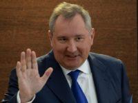 Рогозин се пошегува с вратовръзката си, след като Путин му направи забележка