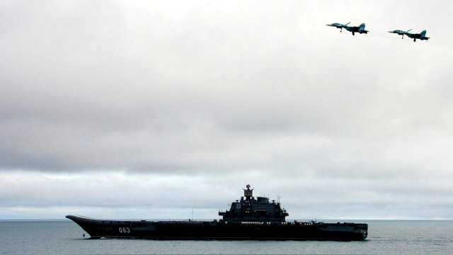 Jet fighters fly over the Russian aircraft-carrier 'Admiral Kuznetsov' during military exercises in the Barents Sea.  Jet fighters fly over the Russian aircraft-carrier 'Admiral Kuznetsov' during military exercises in the Barents Sea, August 17, 2005. Russian President Vladimir Putin oversaw the launch at sea of a ballistic missile on Wednesday, salvaging some honour after the embarrassment of two failed launches on a visit to the fleet last year. REUTERS/ITAR-TASS/PRESIDENTIAL PRESS SERVICE - RTRKT11