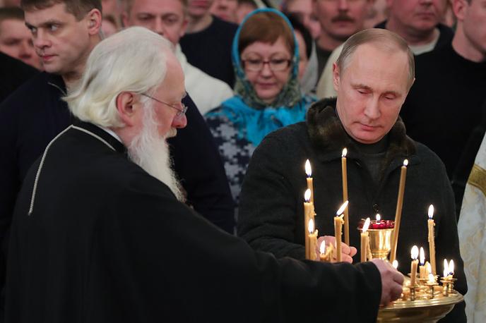 VELIKY NOVGOROD, RUSSIA - JANUARY 6, 2017: Russia's President Vladimir Putin (R) during a Christmas liturgy at St George Monastery. The Russian Orthodox Church celebrates Christmas according to the Julian calendar. Mikhail Klimentyev/Russian Presidential Press and Information Office/TASS Ðîññèÿ. Âåëèêèé Íîâãîðîä. 7 ÿíâàðÿ 2016. Ïðåçèäåíò Ðîññèè Âëàäèìèð Ïóòèí (ñïðàâà) âî âðåìÿ Ðîæäåñòâåíñêîãî áîãîñëóæåíèÿ â Ñïàññêîì ñîáîðå Ñâÿòî-Þðüåâà ìîíàñòûðÿ. Ìèõàèë Êëèìåíòüåâ/ïðåññ-ñëóæáà ïðåçèäåíòà ÐÔ/ÒÀÑÑ
