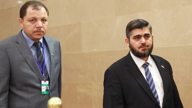 Mohammed Alloush Мохамед Алуиш (вдясно), ръководителят на сирийската опозиционна делегация. / БГНЕС