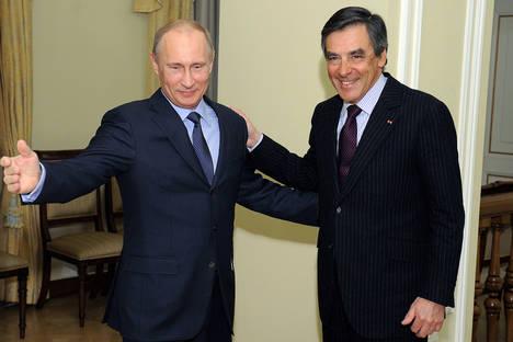 Владимир Путин с бившия френски министър-председател Франсоа Фийон в резиденцията на руския президент Ново Огарьово. Снимка: AP