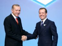 epa05980983 A handout photo made available by the Turkish President Press Office shows shows Turkish President Recep Tayyip Erdogan (L) shaking hands with Russian Prime Minister Dmitry Medvedev (R) during the Black Sea Economic Cooperation (BSEC) Summit in Istanbul, Turkey, 22 May 2017.  EPA/TURKISH PRESIDENT PRESS OFFICE / HANDOUT  HANDOUT EDITORIAL USE ONLY/NO SALES