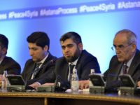 epa05797593 Mohammed Alloush (Ñ) of the Jaish al Islam faction, chief negotiator for the Syrian rebel side, attends a press conference following the second round of talks on the Syrian conflict settlement in Astana, Kazakhstan, 16 February 2017.  A fresh round of talks on the Syria conflict got underway and was backed by Russia, Turkey, and Iran and endorsed by the UN.  EPA/TURAR KAZANGAPOV  EPA/TURAR KAZANGAPOV