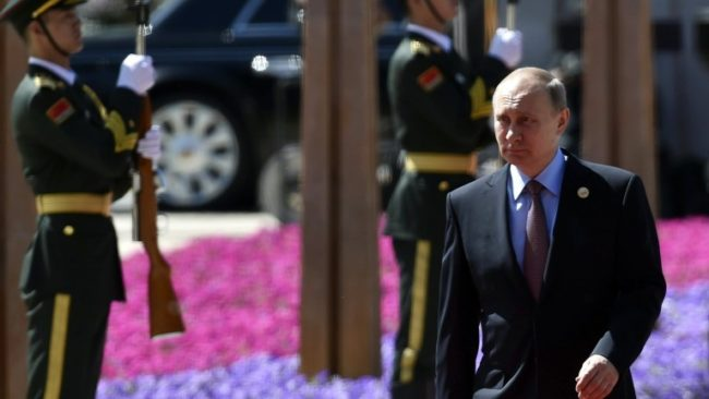 epa05965415 Russian President Vladimir Putin arrives for the welcome ceremony for the Belt and Road Forum at the International Conference Center in Yanqi Lake, north of Beijing, China, 15 May 2017. The Belt and Road Forum runs from 14 to 15 May, and it is expected to lay the groundwork for Beijing-led infrastructure initiatives aimed at connecting China with Europe, Africa and Asia.  EPA/KENZABURO FUKUHARA / POOL