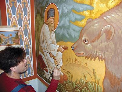 Руският иконописец Николай Шушаликов подновява иконописа на храма в Атон
