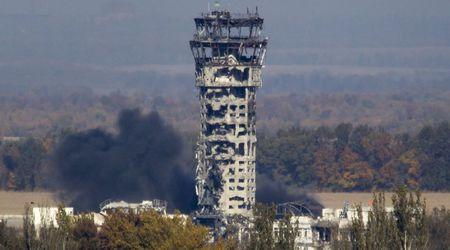 МО на ДНР: Под развалините на летище Донецк има тела в натовски униформи