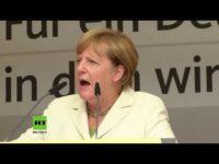 """Сюрпризираха Меркел с плакат """"По-добре Путин!"""" на митинг от предизборната й кампания"""